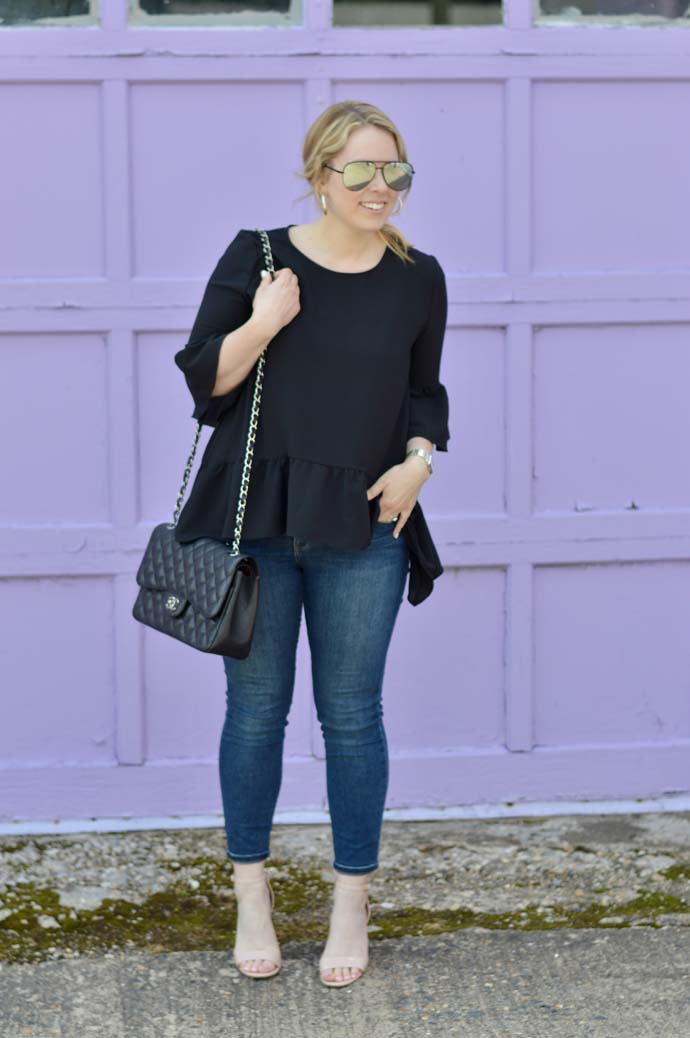 black peplum top and skinny jeans