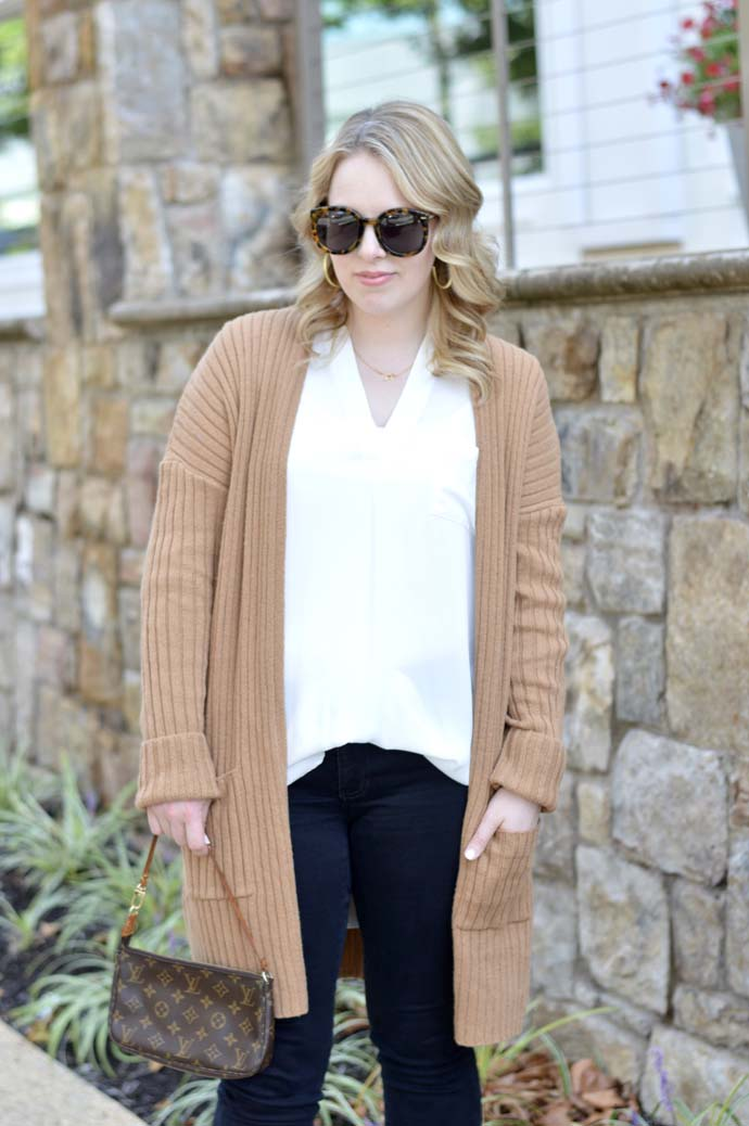 camel sweater white top outfit