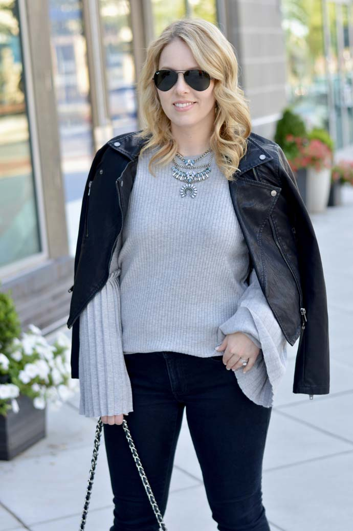grey sweater leather jacket outfit