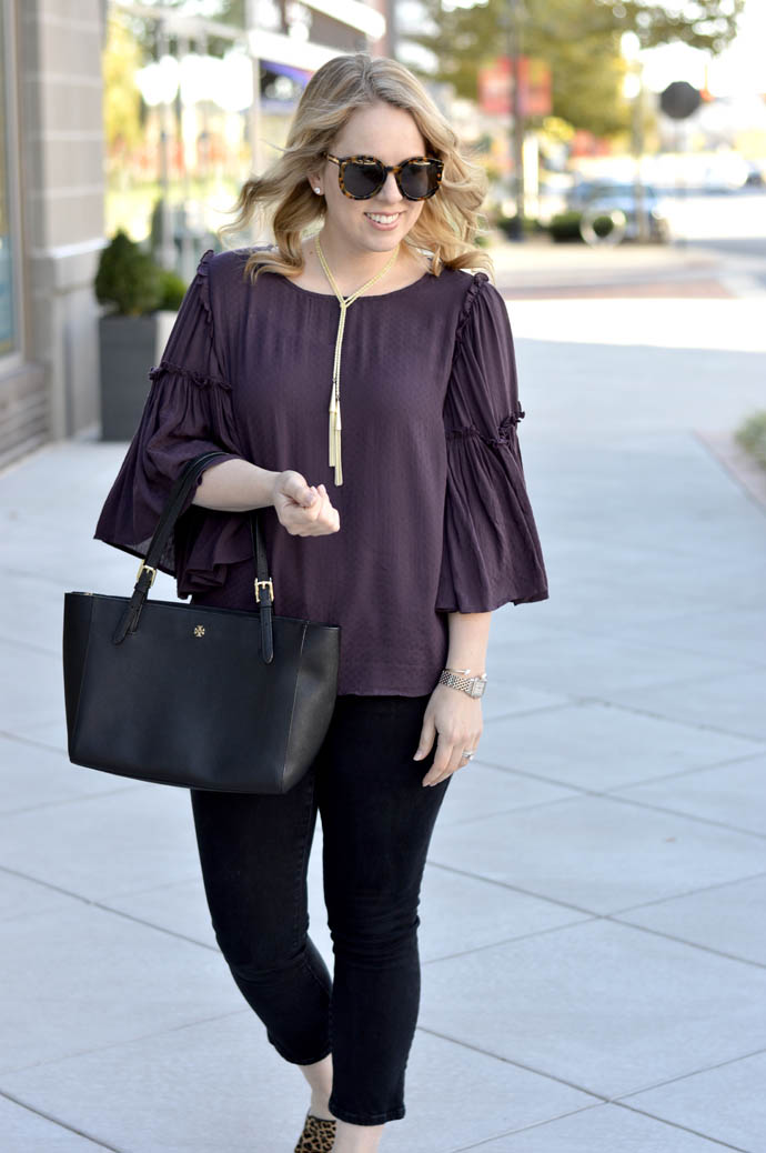 black cropped jeans purple top outfit